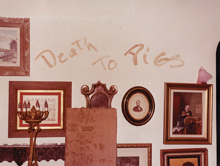 """Using the blood of their victims, Manson Family members scrawled the words """"PIG"""" on a door at the home of Roman Polanski and Sharon Tate and """"Death to Pigs"""" on the living room wall at the home of Leno and Rosemary LaBianca"""