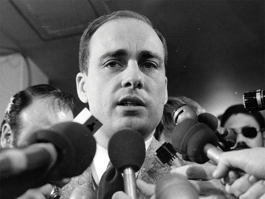 Vincent Bugliosi, who prosecuted the killers, speaks to reporters after winning the death penalty.