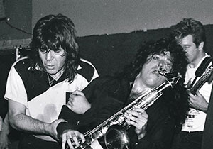Chuck E. Weiss at The Central. Spyder Mittleman on sax and Will Macgregor on bass. Photograph courtesy Todd Everett.