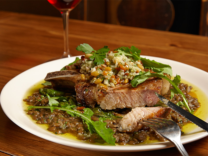 Bone Density: The 18-ounce pork chop, with lentils, chicories, and plum-and-pine nut gremolata