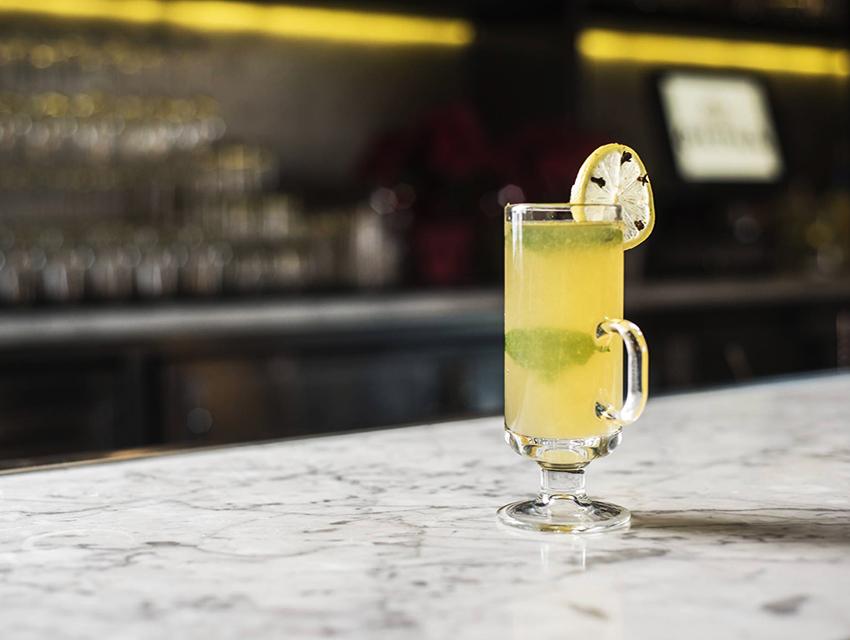 Pistola's Mint Toddy: Jameson Black, honey, allspice dram, Angostura bitters, hot mint tea, and lemon