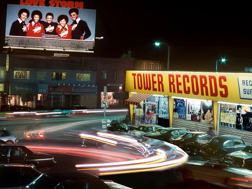"""All Things Must Pass,"" the upcoming documentary about Tower Records by Colin Hanks and Sean Stuart, features Robert Landau's 1980 nighttime photo of the iconic record store from his book, ""Rock 'N' Roll Billboards."""