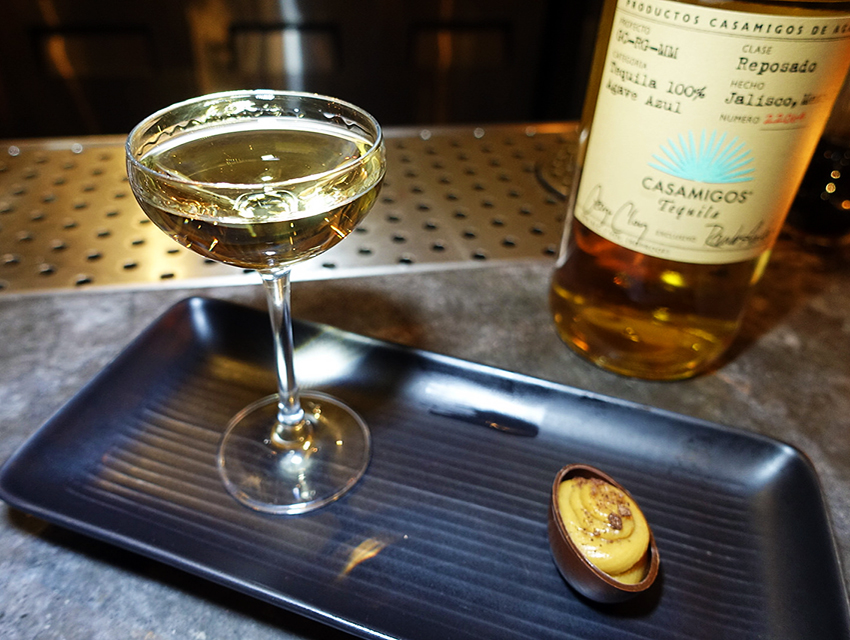 Casamigos Reposado with peanut butter mousse in a chocolate cup drizzled with smoked chocolate salt
