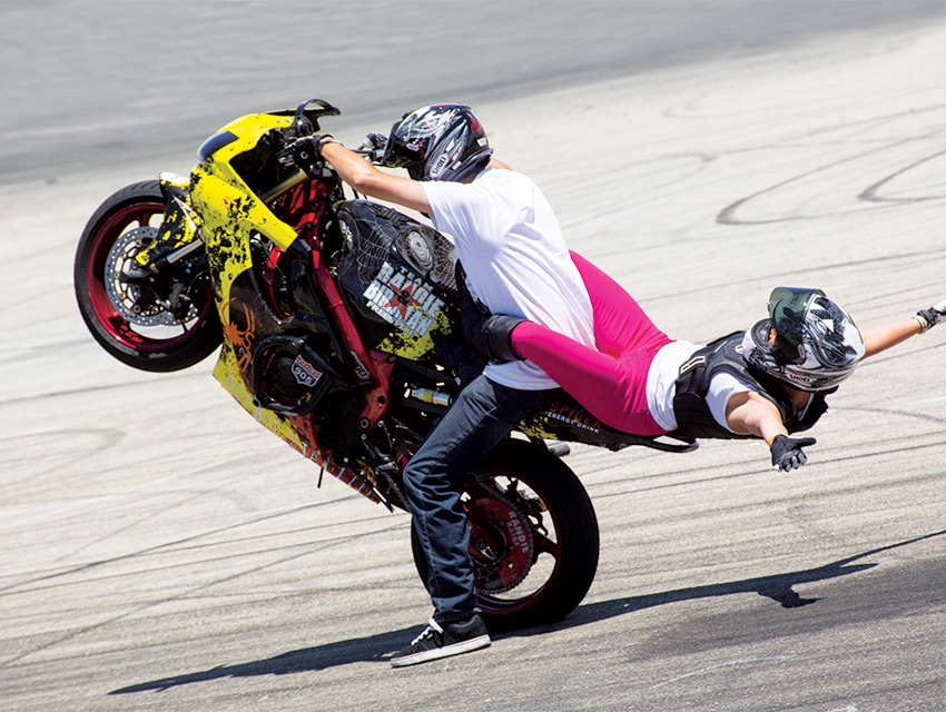"""Thrills, chills, and very few spills. Professional riders Enrique """"Birdman"""" Ponce and Randie Raige tour the world with their two-wheel acrobatics"""