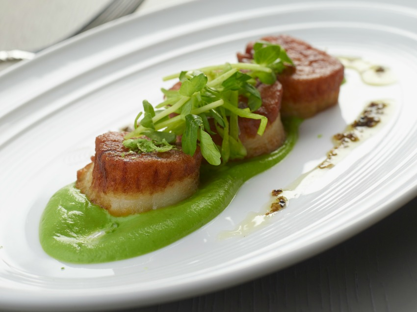 Andiron proves it's a lot more than just a steakhouse with dishes like these Maine scallops.