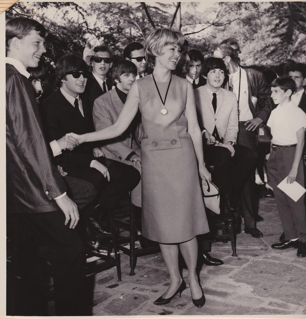 Actress Barbara Rush meets the Beatles. Her husband, publicist Warren Cowan, was in charge of the guest list.