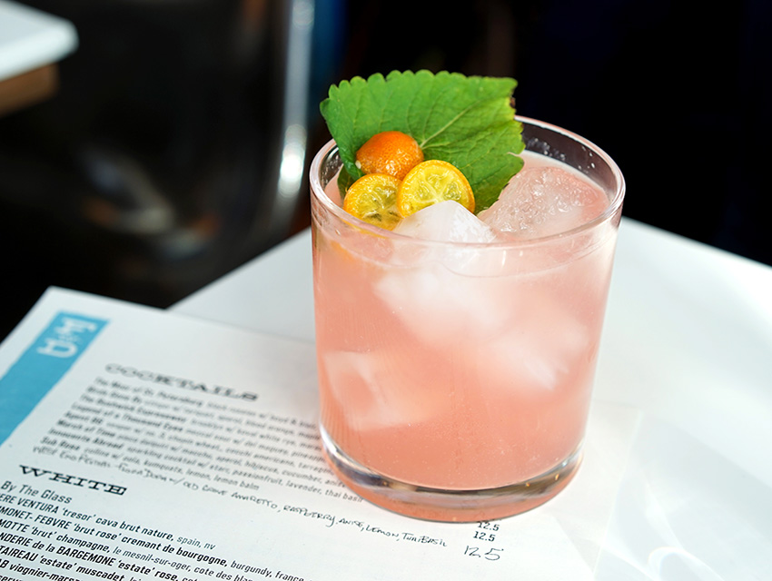 Fishing With Dynamite's Sub Rosa: lemon balm syrup and soda garnished with a lemon balm leaf and candied kumquats