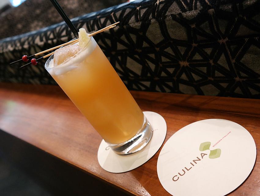 Culina's Sunset Buck: mezcal. Aperol. fresh pineapple. ginger. Peychaud's bitters