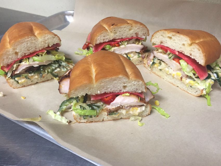 Mendocino Farms is putting the finishing touches on its smoked chicken and street corn torta.