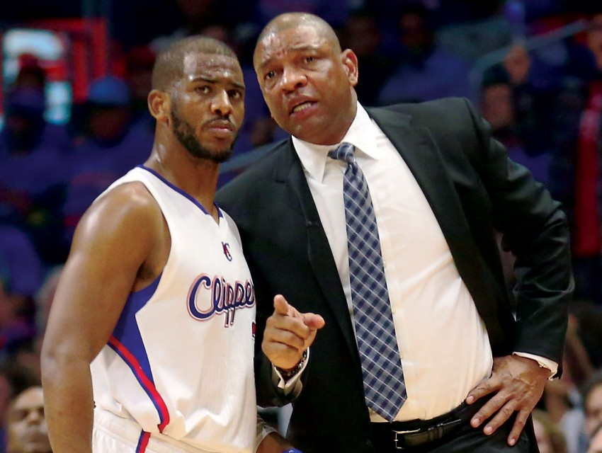 Clippers head coach Doc Rivers and All-Star guard Chris Paul confer on the court.