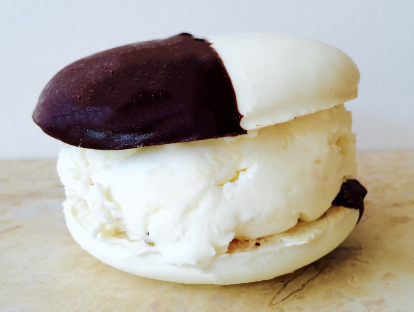 A black and white cookie with cream cheese and rye ice cream