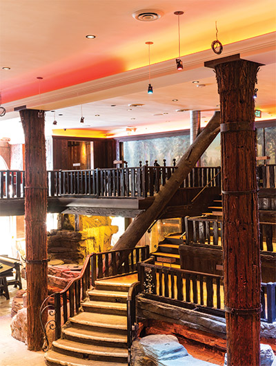 The Tree Tops Bar gets its name from the venue's fanciful forest canopy