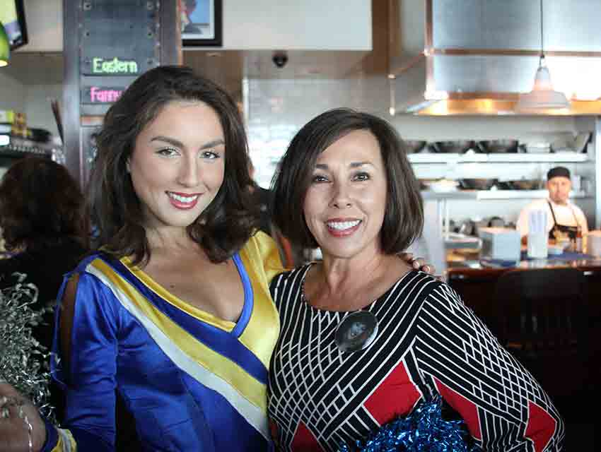 Janelle Liebl, left, modeling the Rams cheerleader uniform of her mother, Janet Cournoyer.