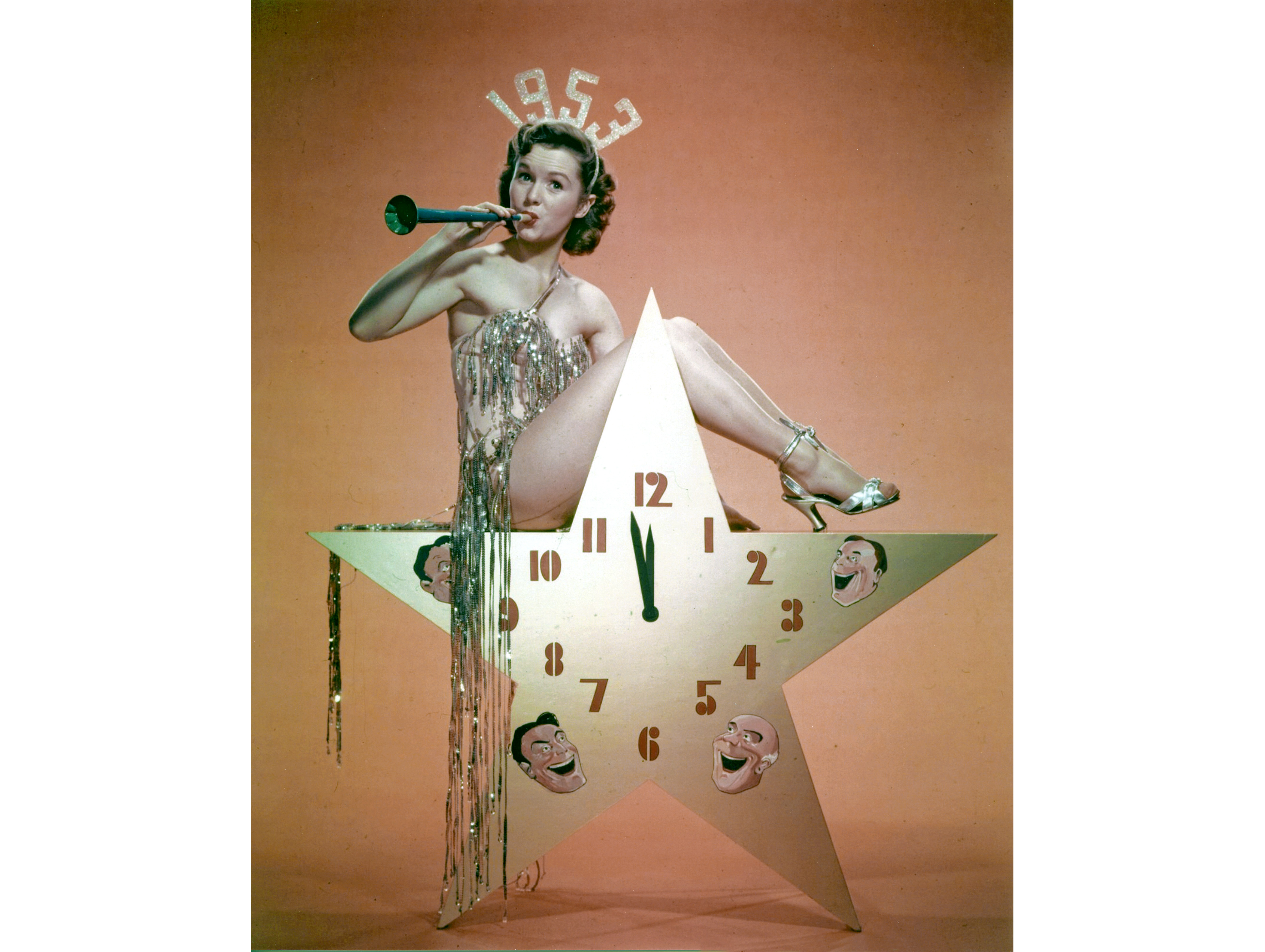 Debbie Reynolds sits atop a star to welcome the New Year of 1953