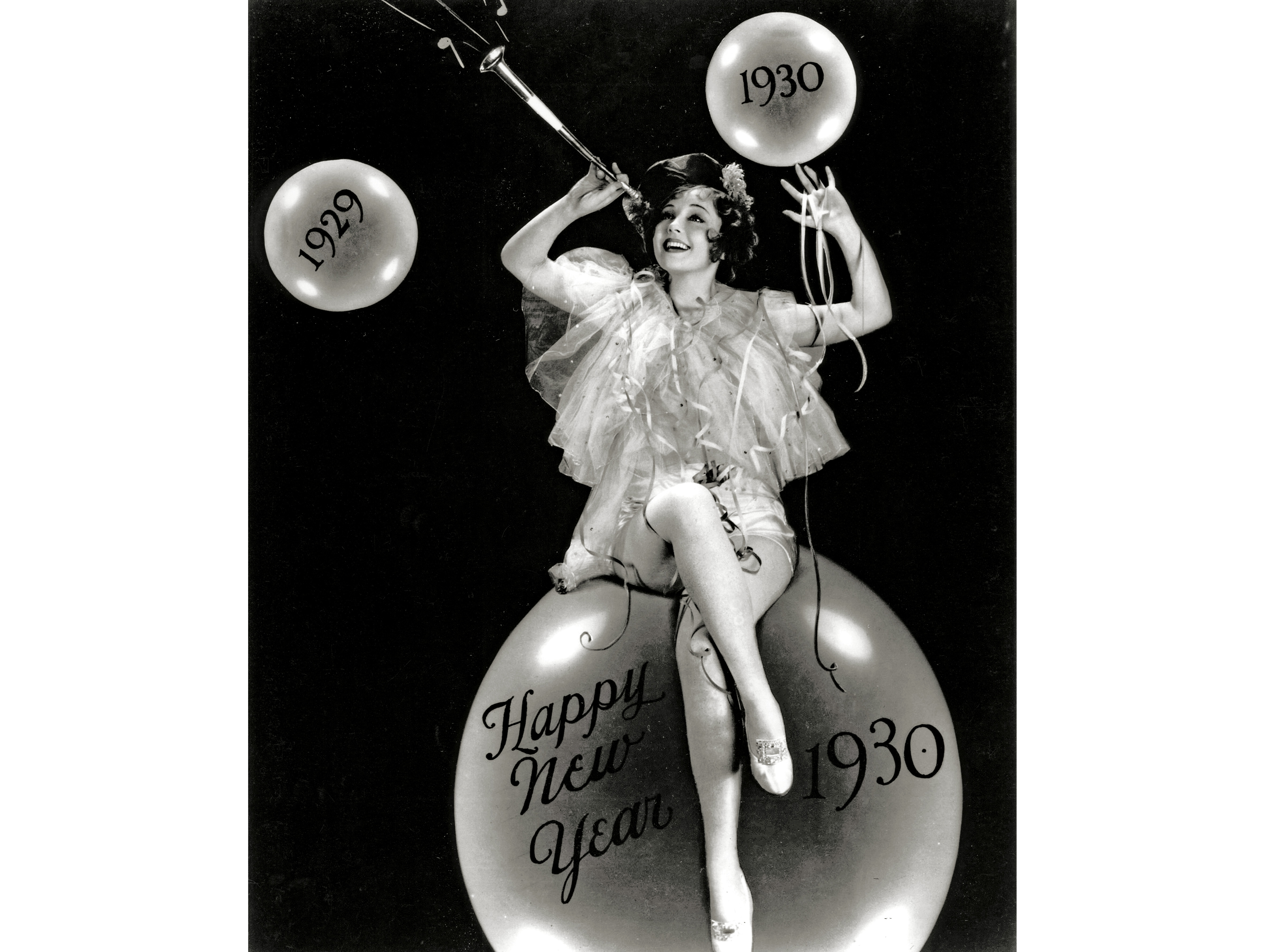 Nancy Carroll sits atop a champagne bubble to help ring in 1930. Her effervescent, bubbly personality matched the heady, dizzying spirit of the 1920s.
