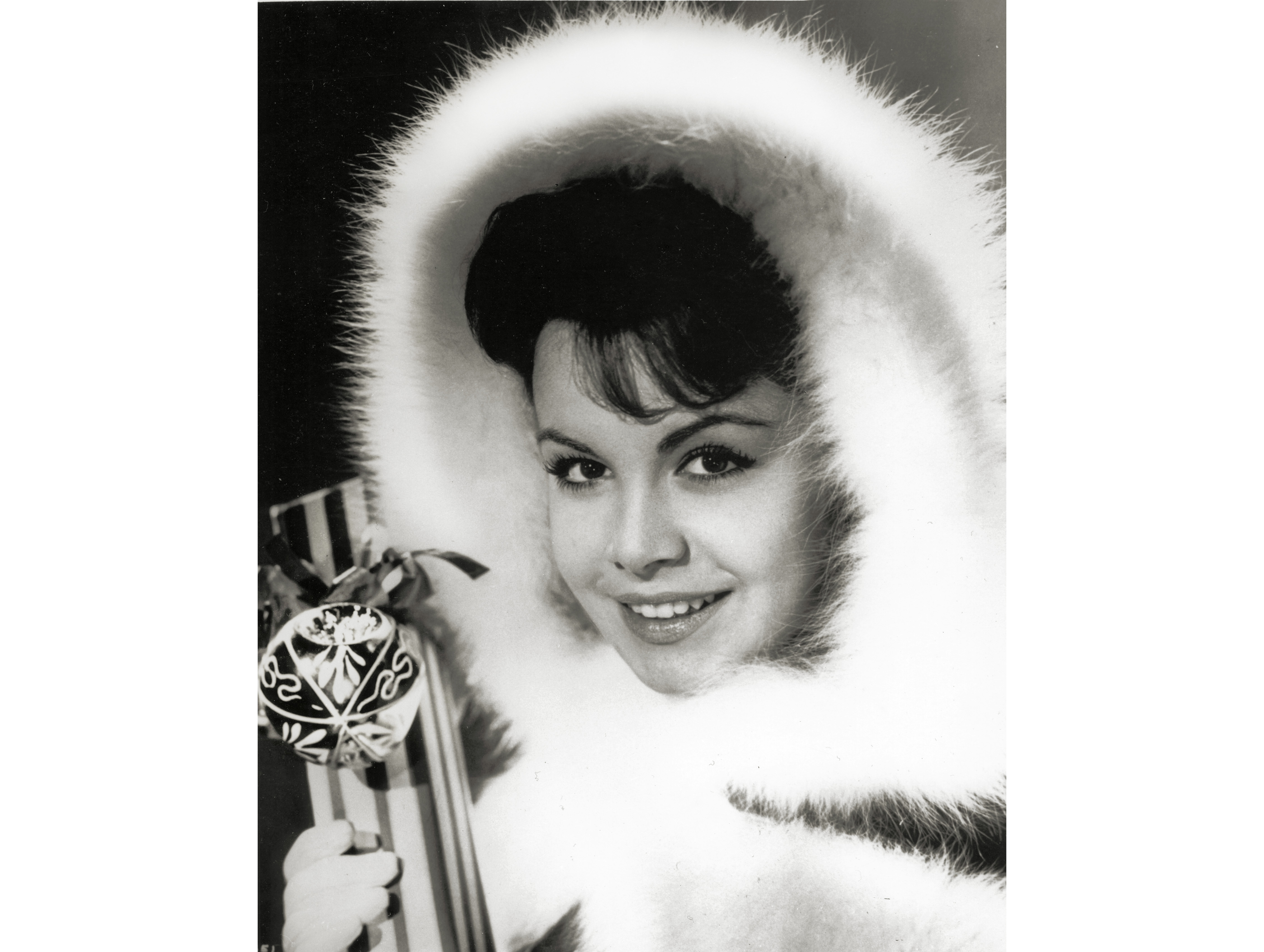 Perky, petite, 1960s American Sweetheart, Annette Funicello, bundles up for a romantic holiday season.