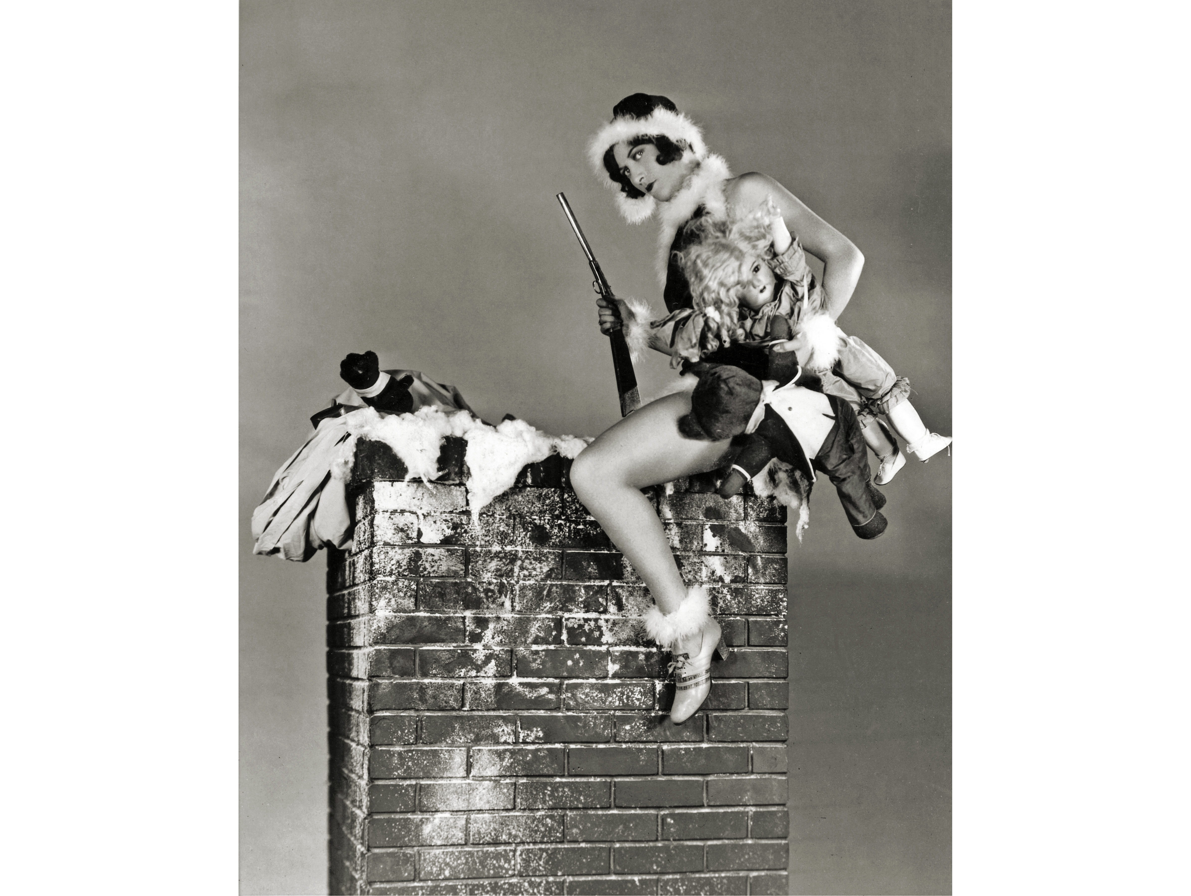 Here comes Santa Claus in the guise of Joan Crawford, bringing presents for all good boys and girls.