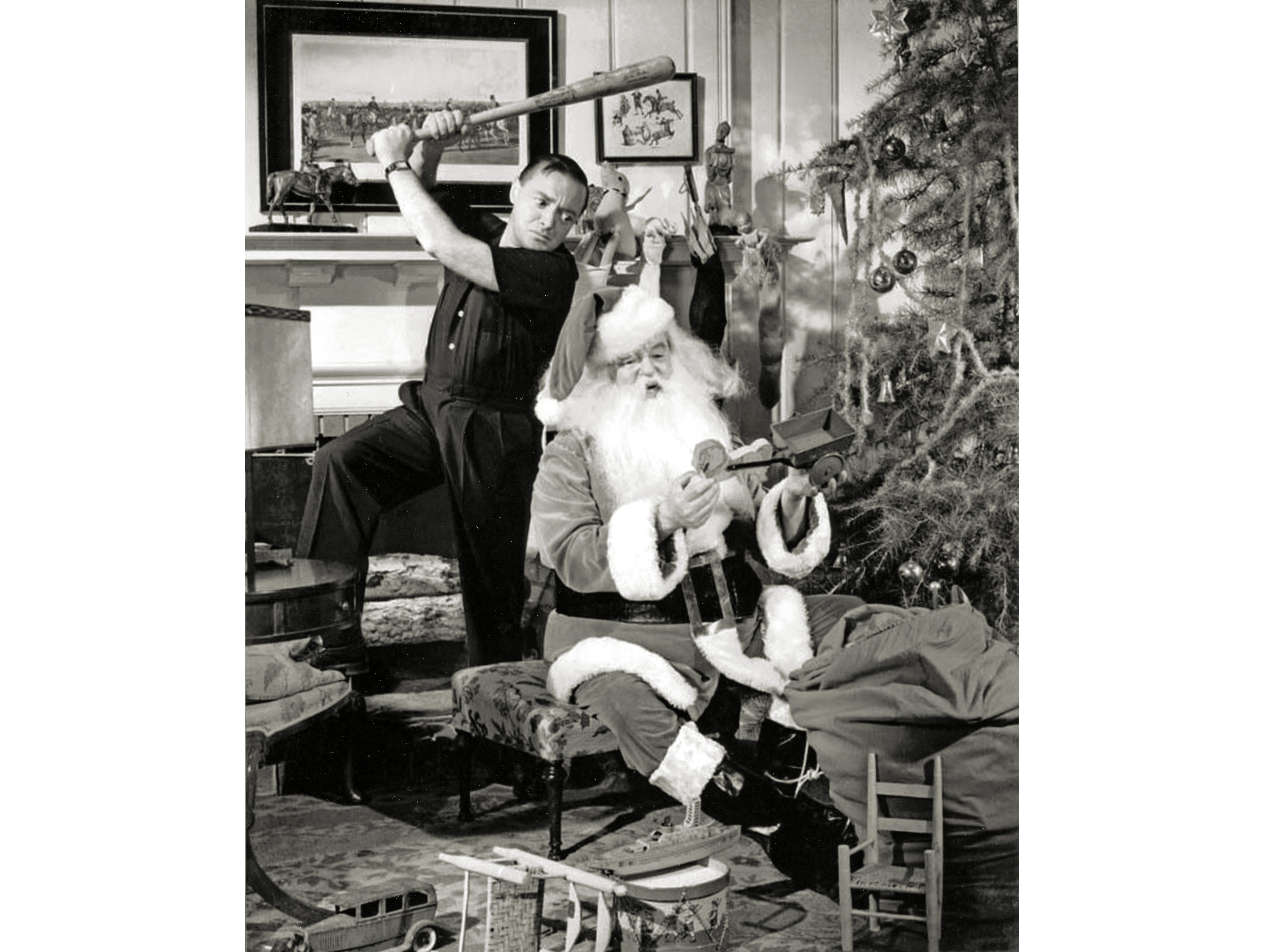 A vicious Peter Lorre prepares to ring in the holidays by swinging at Sydney Greenstreet's gentle Santa Claus.