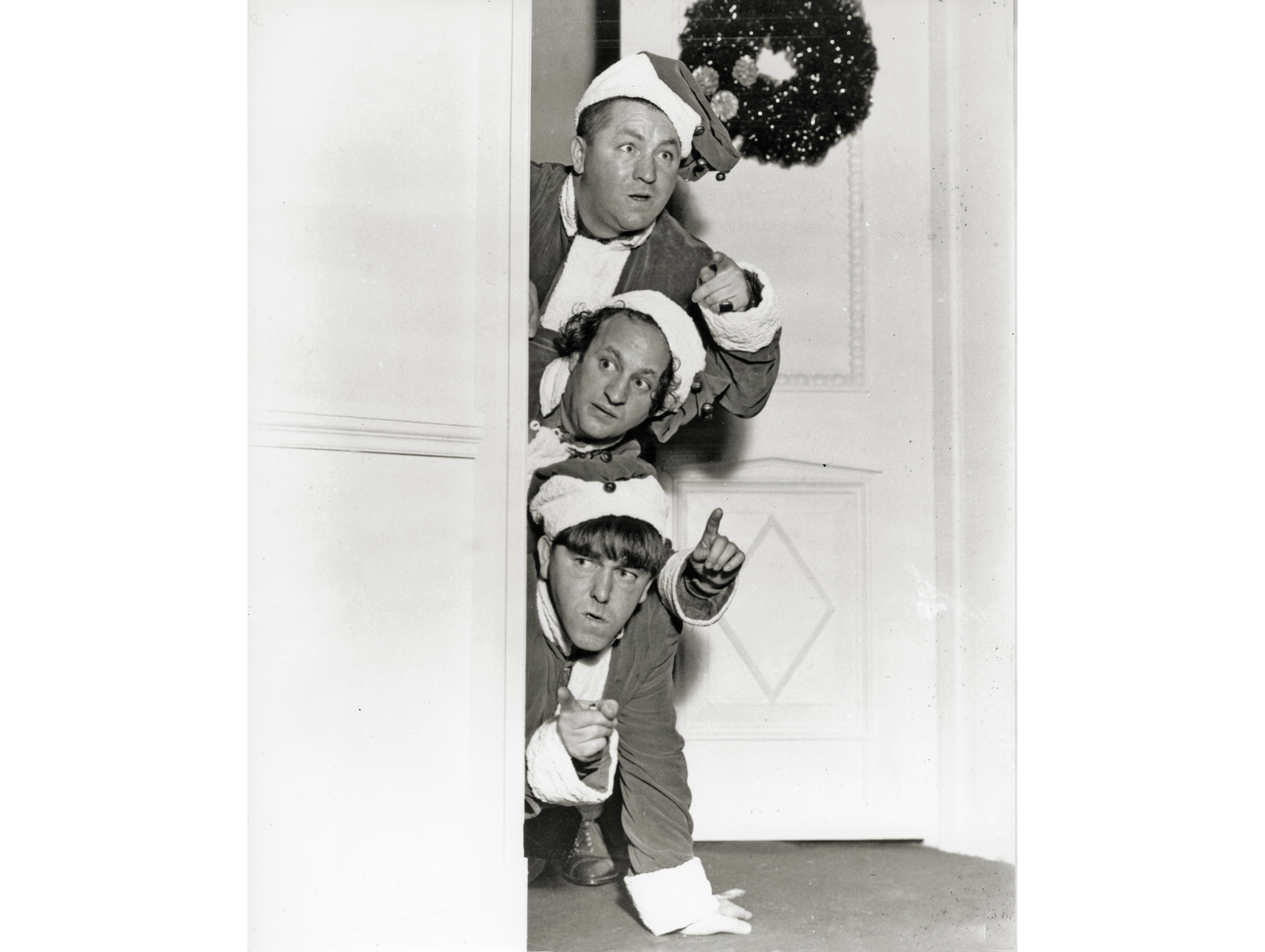 Slaphappy Santas the Three Stooges (Curly Howard, Larry Fine, Moe Howard) watch to see who's been naughty or nice for Christmas.