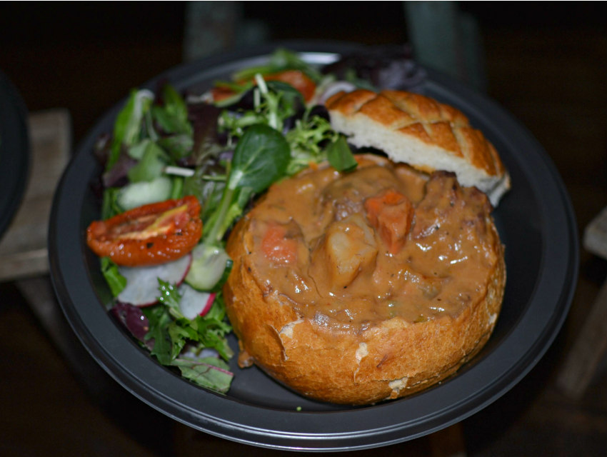 Beef and lamb and Guinness stew in a bread bowl