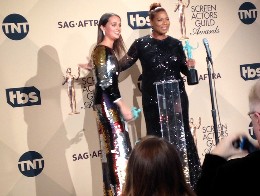 Alicia Vikander and Queen Latifah backstage at the SAG Awards