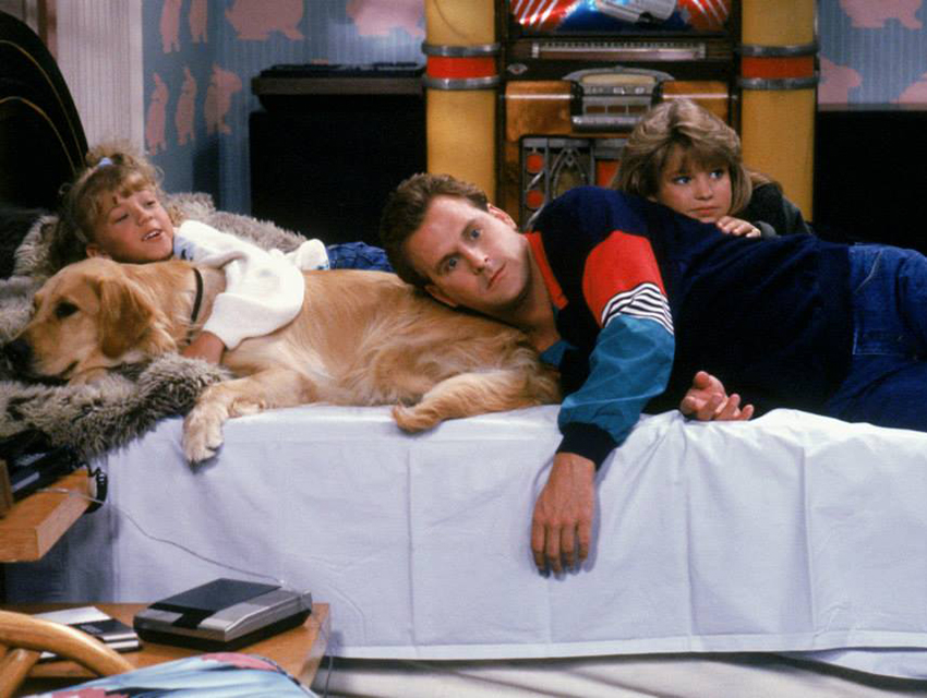 Coulier as Uncle Joey, lounging with DJ (Candace Cameron Bure) and Stephanie (Jodie Sweetin)