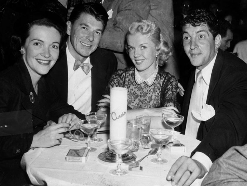 Jeanne and Dean Martin celebrating the upcoming nuptials of Nancy Davis and Ronald Reagan at Ciro's in February 1952