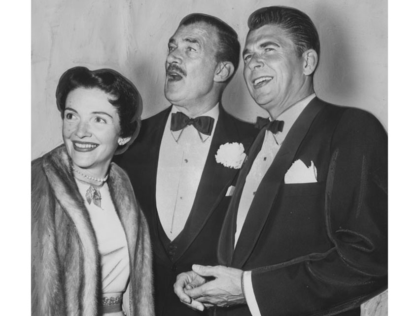 Ronald and Nancy Reagan with Walter Pidgeon in the lobby of the Egyptian Theater