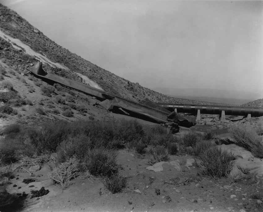 Result of the dynamite on the aqueduct with water flowing down hillside