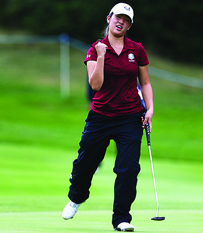 Andrea Lee celebrates a well-hit putt at Blairgowre Golf Club in Scotland, where she competed on the U.S squad that won the 2014 Junior Ryder Cup