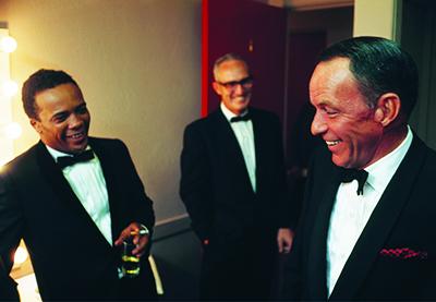 Jones and Frank Sinatra in Sinatra's dressing room in 1964