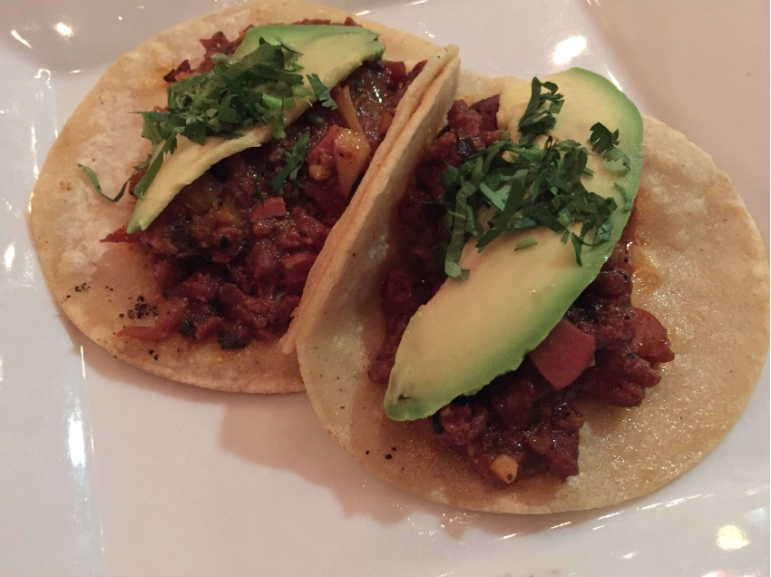 Discada tacos are served with a slice of avocado