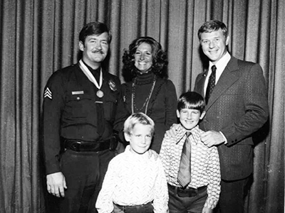 During his 1972 Medal of Valor ceremony, Barrett, his wife, and sons (author at right) posed with Adam-12's Martin Milner