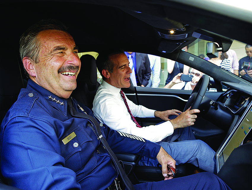 Beck and Mayor Eric Garcetti last September in an electric car slated to join the LAPD's fleet