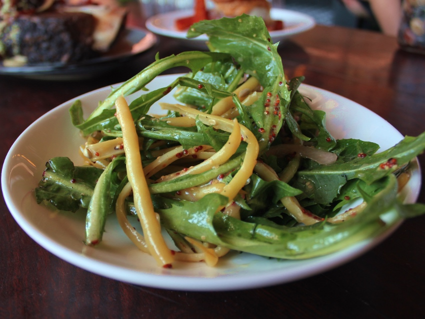 The Dandelion salad with wax beans and dijon onions