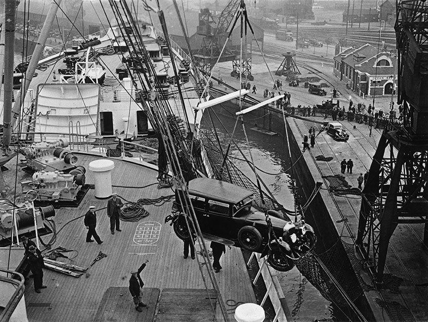 A limousine is hoisted onto the deck of the new Cunard White Star liner Queen Mary hours before her departure on her maiden voyage from Southampton to New York.