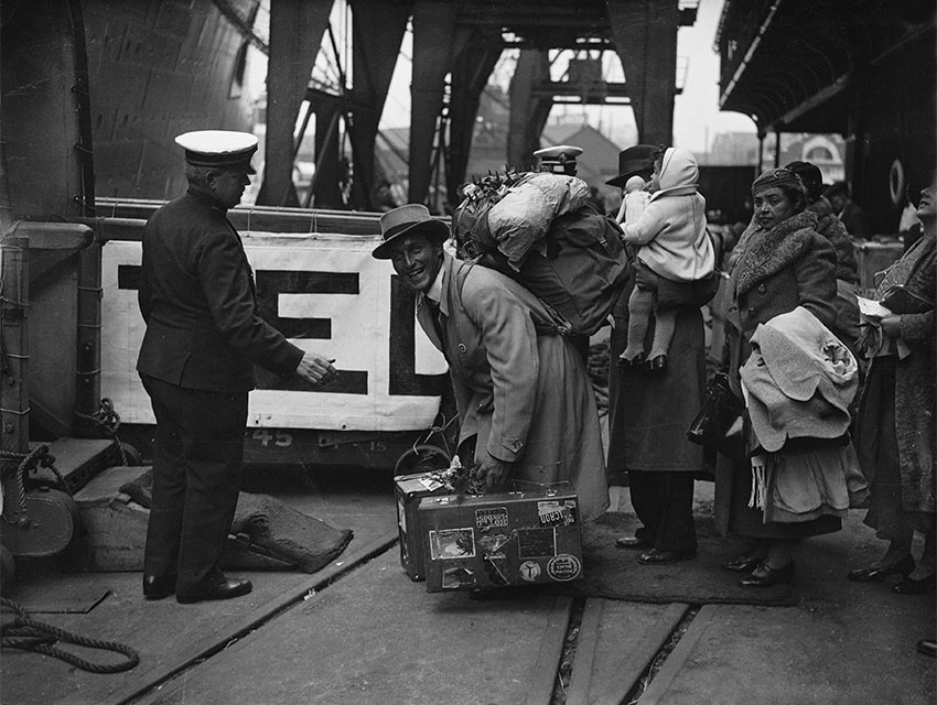 Passengers boarding the Cunard White Star Liner Queen Mary at Southampton before her maiden voyage to New York.