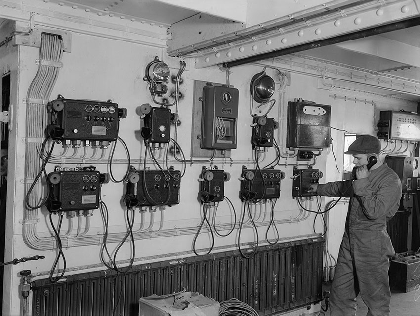 5th March 1936: The telephone control room on board the SS Queen Mary, which is nearing completion at the shipyard on Clydebank, Scotland.