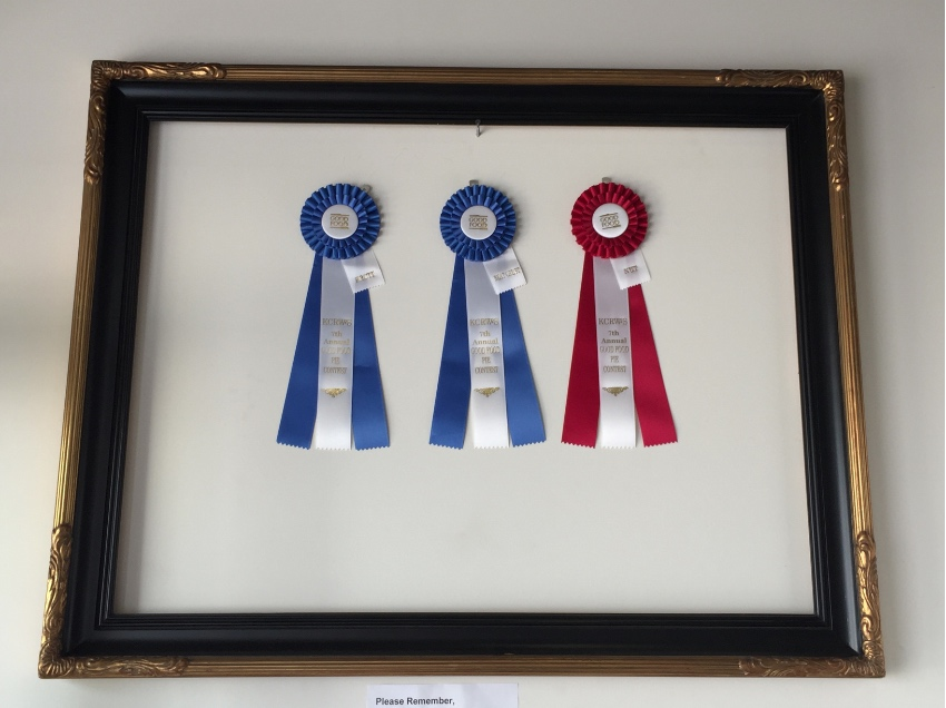Tracy DeVore's KCRW ribbons are proudly displayed in the shop