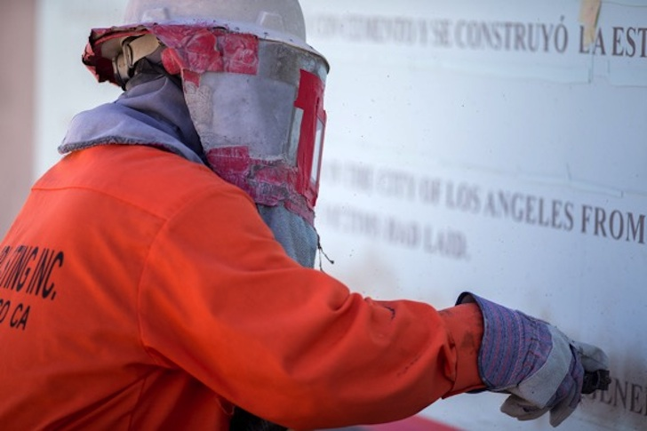 Teresa Margolles inscribing the sculpture during a ceremony on July 21, 2016.