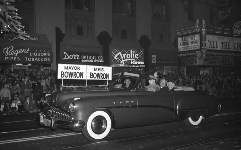 The mayor and his wife cruise west on Hollywood Boulevard past the Pantages theater and the Frolic Room
