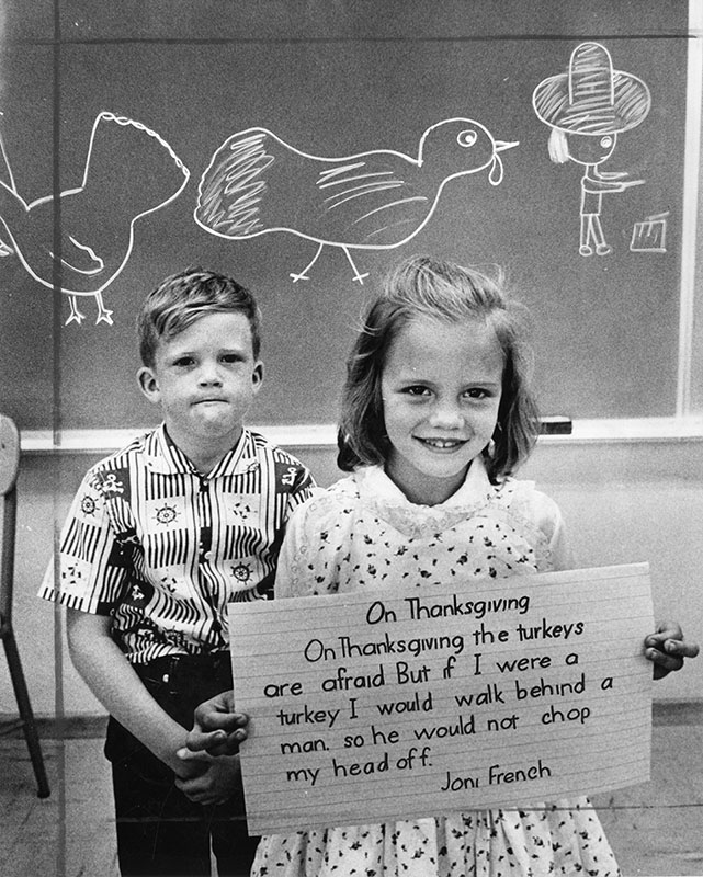 "Photograph caption dated November 15, 1961 reads, ""Kevin Brown, 7, and Joni French, 7, Sylmar, tell Thanksgiving Story."""