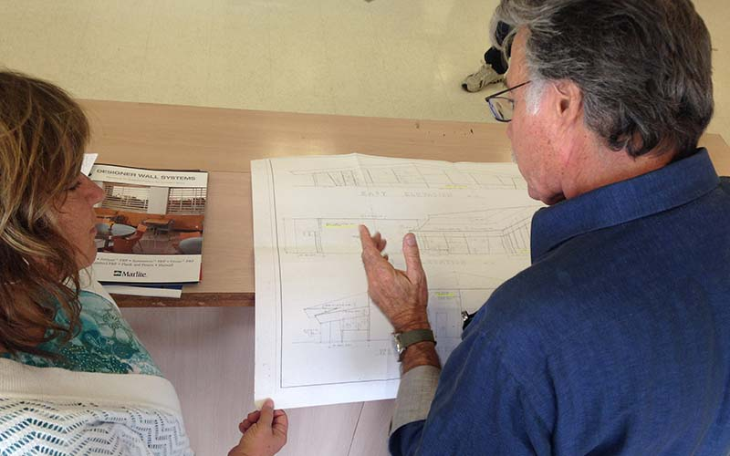 Preservation consultant Adriene Biondo goes over plans with Mel's owner Steven Weiss