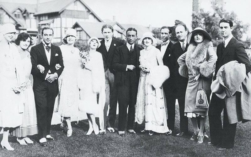 The wedding party of David Mdivani and Mae Murray (center, with bouquet) included best man Rudolph Valentino (third from left) and movie producer Irving Thalberg (center).