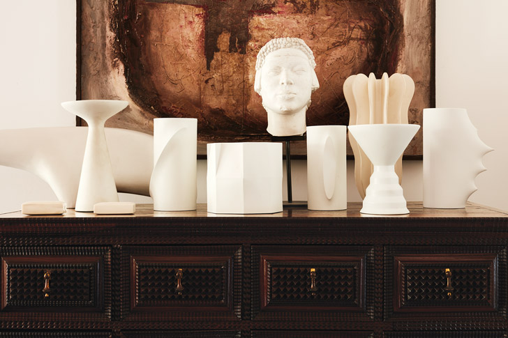 Smooth white ceramics by artists such as Italian architect-de-signer Ettore Sottsass form a still life atop a carved early-19th-century Portuguese chest of drawers