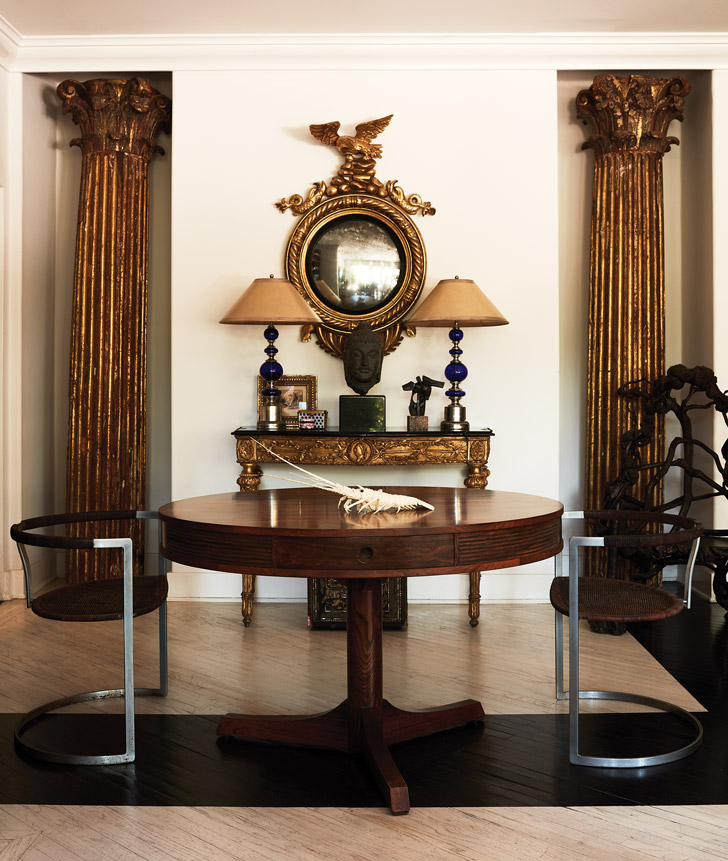 A pair of 18th-century Italian columns from Hearst Castle flank an English table by Robert Heritage and Danish chairs by Preben Fabricus and Jørgen Kastholm