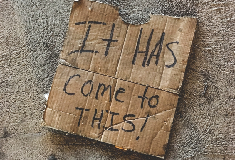 homeless sign skid row