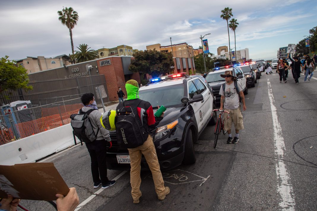 protester hit by lapd car protests los angeles