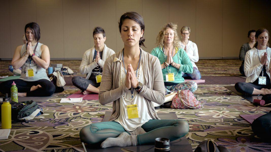 wellness conspiracy qanon yoga