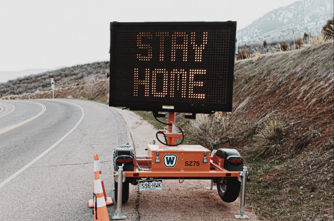 stay home order curfew pandemic traffic sign